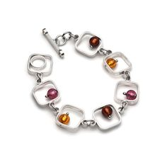 """Hand crafted sterling silver bracelet with rounded square links punctuated with Venetian beads. The bracelet closes with an asymmetrical toggle clasp.Sterling silver, Murano glassLength - 7 1/2"""""""