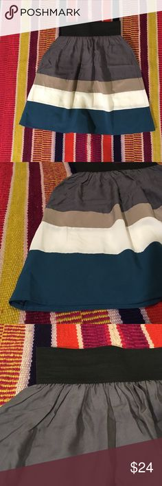 """Modcloth NWOT flare mini skirt Modcloth """"Ocean Aura Skirt"""" (My Story brand, purchased from Modcloth). NWOT color-block flared mini skirt with black elastic band for a perfect fit. So cute! Colors from top: black, gray, tan, cream, teal blue. 21.5 in. length from top of waistband. Waist unstretched is 12 in. across (not circumference), but this is meant to be stretched when worn and sit at the smallest point of your waist. ModCloth Skirts Mini"""