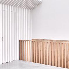 #mclarenexcell #architecture #interiors #concretefloor #oak #cladding #hiddendoor #stairs #light #balustrade