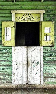 green weathered door with interesting details