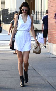 Kendall always keeps her outfits super simple, but by sticking to super-chic black and white, she still looks super stylish. Throw on a jersey dress with mid-calf boots for a look that's comfy enough to rock to class and cute enough to wear to hang with your crush after school.
