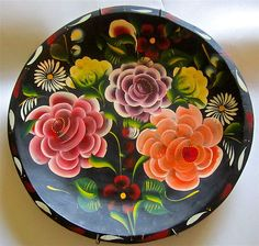 Bateas are wooden trays or bowls usually hand painted black and then toll painted with flowers or more rarely lake scenes.  Most are made in Quiroga, Michoacán on Lake Patzcuaro and have been for generations.  For more on Mexico visit www.mainlymexican.com