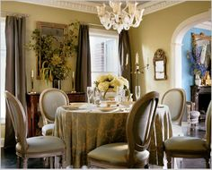 French oval chairs, floral table cloth and golden walls