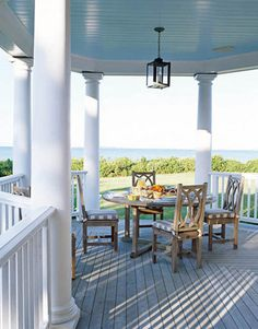 The expansive porch and a Balmoral teak dining table by Barlow Tyrie take the place of a formal dining room.