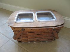 This picnic basket food bowl holder. | 19 Brilliant DIY Projects For Pet Food Stations