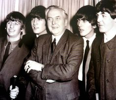 The Beatles were with Mr. Wilson. Read more about the Beatles here at beatlesfansunite.com. Join for free and vote for your favorite Beatles.