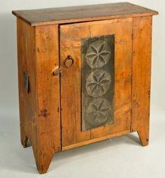 antique pie safe with pinwheel tins