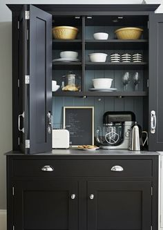 A practical, large freestanding larder painted in black makes for the ideal breakfast cupboard - kitchen storage Kitchen Larder Cupboard, Kitchen Dresser, Shaker Kitchen, Kitchen Furniture, Kitchen Interior, Interior Doors, Craftsman Interior, Country Furniture, Farmhouse Furniture