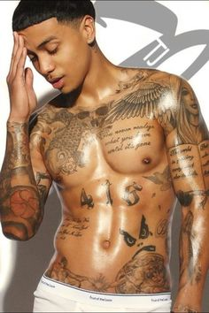 Hot body-hot tats. I love how the placement of his tats all seem to cradle his muscles perfectly