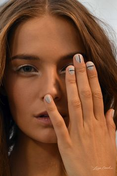 Backstage Beauty: Spring 2014 Manicure at Tibi. The minimalist nail art at Tibi was chic, simple, and easy to recreate. For this look, manicurists started with JINsoon Power Coat, then applied two coats of a blue-gray from JINsoon's upcoming collection, and then added vertical and horizontal lines using a nail art brush dipped in JINsoon Obsidian.