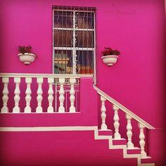 Pink Building in Capetown fr HP article-  Richest Black Woman In The World, Folorunsho Alakija, Was A Major Fashion Designer In Africa#sb=1050542,b=facebook