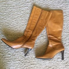 SALECamel/Tan Knee High Nine West Boots Nine West Camel/Tan Knee High Boots. In excellent condition have just gotten back from shoe repair, having the leather upper reconditioned. Used handful of times & stored. See picture of soles. No scratches. Size 6.5. Nine West Shoes