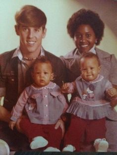 Tia and Tamera Mowry as babies with their parents.