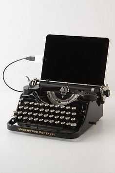 An old Underwood typewriter adapted to work as an iPad keyboard dock.  Why can't new technology look this good?