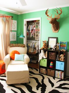 Bright and colorful green, orange teal baby boy nursery