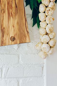 Cutting Board. Olive solid wood. Objects for the table that contain the strength of a big tree. Monolithic objects, where time has left its fascinating signs over the centuries. Open flame finished edges enhance the design of cracks and chinks.