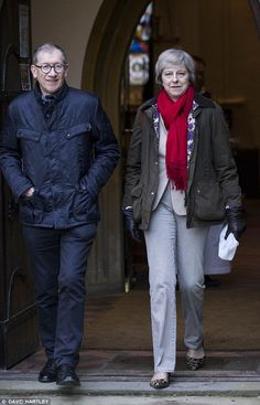May sported a paired-back look as she wrapped up in a red scarf, which she teamed with a £...