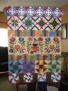 Round Robin Row Quilt...I did the middle row with the house and everyone added on, Love my quilting friends!!