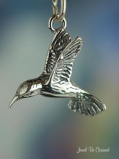 Sterling Silver Hummingbird Charm Flying Pretty Bird and Garden Theme. $9.95, via Etsy.