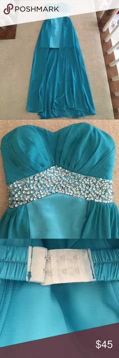 Turquoise High-Low Dress Beautiful turquoise dress ordered online from overseas but is really good quality. Only worn once to senior prom. Doesn't have a size tag in it but would fit a 0/2. Comes with an elastic band with clasps inside so it fits to you and won't fall down. Dresses
