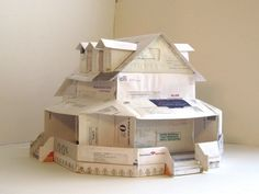 Junkculture: Artist Builds Houses out of Credit Card Applications
