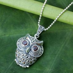 NOVICA Thai  Silver and Marcasite Owl Necklace with Garnets (235 BRL) ❤ liked on Polyvore featuring jewelry, necklaces, garnet, pendant, silver necklace, owl jewellery, owl pendant, silver jewelry and pendant necklaces
