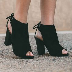 The party never ends in these black Party People Heels! Featuring a faux suede material, open-toe styling and open back with lace-up detail on the ankle. Stacked block heel. Cushioned insole and rubbe