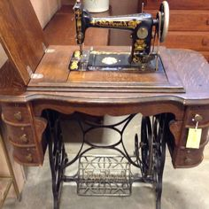 Antique New Royal treadle sewing machine with an art deco cabinet with six drawers. Made by Illinois Sewing Machine Co. There is a metal plate that says 6–13259. $250.00 USD  Booth 312