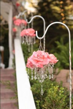 Mini tea light chandeliers filled with flowers for a wedding.