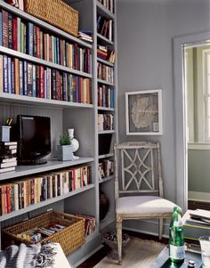 To get the best style from your storage, combine freestanding pieces, such as the baker's cabinet in the dining room, with built-in shelves like those in the library.