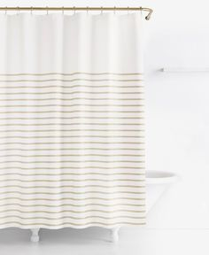 """The bold stripes of the Harbour shower curtain from kate spade new york bring a splash of modern style to your bathroom decor. 