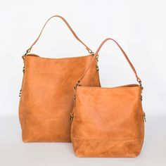 af810d826a64 The lovely bucket bag is soon to be your new favorite purse. Its short  strap