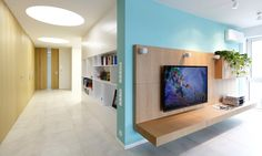 Relaxing Spacious Apartment for Large Family: Bright Colours Shocking Installed On The Single Wall Behind The Floating TV Unit To Break Neutral Living Space Interior Scheme ~ SQUAR ESTATE Apartment Inspiration