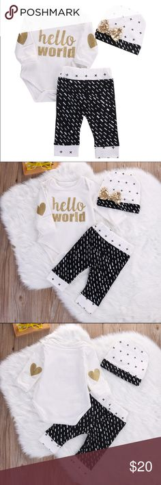 "Hello World Baby Girl 3 Piece Outfit Set Gold Hello World 3 piece baby girl outfit. This outfit is so adorable for a little fashionista! The bodysuit had the most adorable heart elbow patches. The pants are black and white printed dashes. Too cute! Please note the sizing below as the outfit is a European size about equal to a 6-9 month outfit.   Bodysuit- bust 10"" // length 15"" Pants- 7.5"" // length 13.5""  Hat (runs large) - 7"" at base, 6"" long Matching Sets"