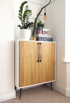 IKEA METOD wall unit with sawn oak HYTTAN doors with custom glossy white panel frame, vintage legs and iron handles