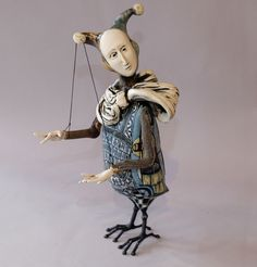 Robin & John Gumaelius  Man Bird in Jester Hat || Ceramic & metal sculpture || 11 inches tall || Arms are madrona wood and articulate |
