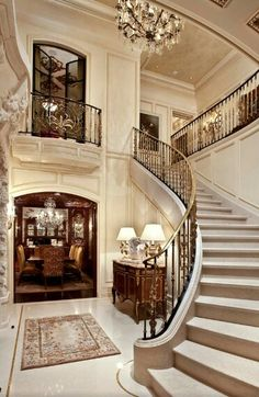 Gorgeous foyer and staircase.from Divine Design.this is my New York row house for when I feel like a week long shopping excursion. Grand Staircase, Staircase Design, Curved Staircase, Winding Staircase, Beautiful Interiors, Beautiful Homes, Luxury Homes Interior, Interior Design, Modern Interior
