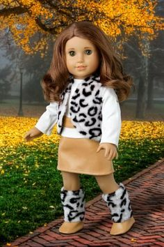 Snow Leopard - Faux fur vest and boots matched with a mini leather skirt and ivory blouse - Clothing for 18 inch Dolls - American Girl Doll Clothes by DreamWorld Collections, http://www.amazon.com/dp/B005U8HA4G/ref=cm_sw_r_pi_dp_tAV3qb012N7TT