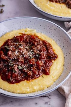 This braised beef ragu recipe is amazing served with creamy polenta or fresh pasta. The beef is slow cooked in the oven until it can be shredded and coated in the rich tomato and red wine sauce. #thecookreport #beefragu #beefrecipe #comfortfood