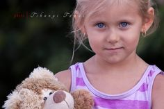 Little girl with here teddy bear