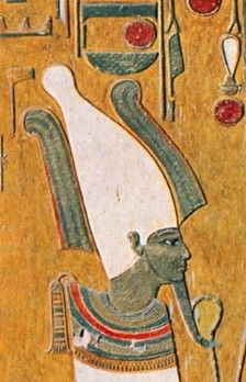 The crown in the picture is an Atef, most typically depicted on Osiris.  The objects on the left and right of the Atef are ostrich feathers.