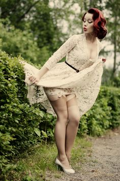 Pin Up. That dress, the color of her hair, and the short floral slip... <3