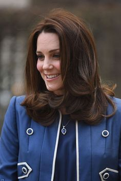 Kate, who was sporting a slightly darker shade of chestnut brown, showcased a bouncy blow ...