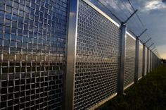 Fence 1200x798 Metal Fence Part Of A Metal Grid Fence With Barbed Wire ...