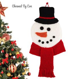 This jolly fellow would be great hanging on the front door to welcome friends, or just as a decorative wall hanging in the home. The Snowman Wall Hanging is an easy crochet pattern that helps you create your own flat snowman motif. You'll be working with multiple colors, both within the same piece and for separate pieces to sew together at the end, so if you're worried about color changes, don't be - this is an easy enough pattern to practice on. Hang this friendly crochet snowman on your…