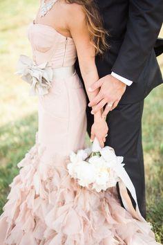 Strapless, Blush Dress with Ruffle Skirt   Photography: Style & Story Creative. Read More:  http://www.insideweddings.com/weddings/catholic-ceremony-romantic-modern-outdoor-wedding-reception/851/