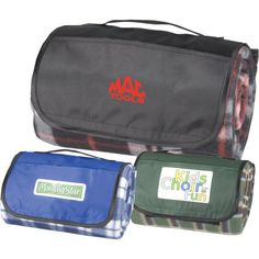 Plaid picnic blanket. Made of 100% polyester fleece with waterproof foam backing, rolls up with a velcro closure for easy transport and features an attached built in handle.