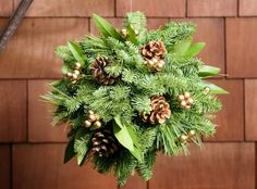This festive orb is a combination of fragrant noble fir, white pine, and bay leaves adorned with Australian pine cones and red or gold faux berries. Types Of Christmas Trees, Christmas Greenery, Christmas Time, Christmas Wreaths, Christmas Ornaments, Christmas Decorations For The Home, Xmas Decorations, Flower Decorations, Holiday Crafts