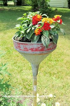 creative recycling ideas for the garden! vintage funnel on broomstick