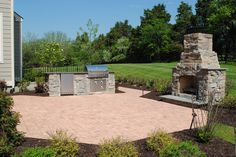 Outdoor space designed by @TheWordGroupInc, thewordgroupinc.com #landscapedesign #patio #outdoorkitchen #outdoorfireplace